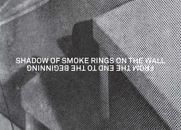 SHADOW OF SMOKE RINGS ON THE WALL